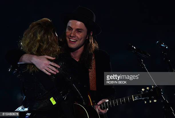 Singer Tori Kelly and James Bay perfrom onstage during the 58th Annual Grammy music Awards in Los Angeles February 15, 2016. AFP PHOTO/ ROBYN BECK /...