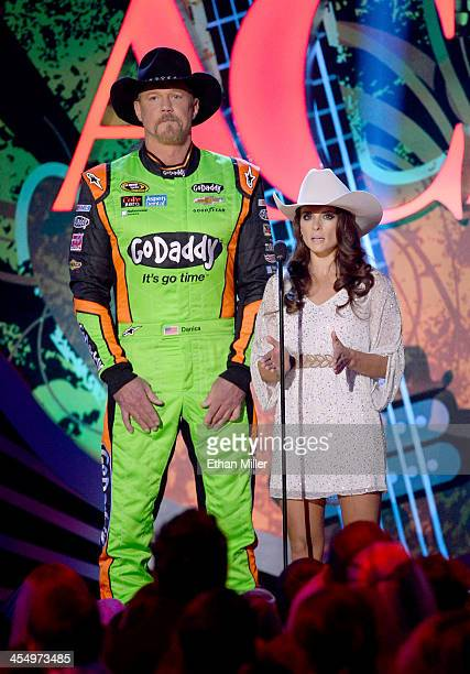 Singer Trace Adkins and NASCAR driver Danica Patrick co-host the American Country Awards 2013 at the Mandalay Bay Events Center on December 10, 2013...