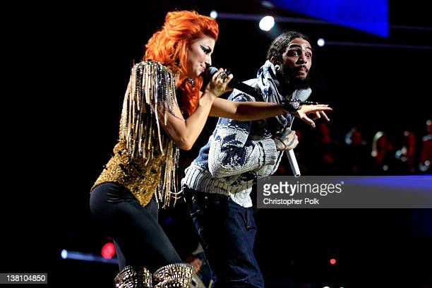 Singer Travie McCoy of Gym Class Heroes and Singer Neon Hitch perform onstage during VH1's Super Bowl Fan Jam at Indiana State Fairgrounds Pepsi...