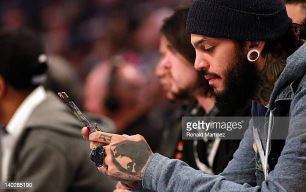 Singer Travie McCoy of the Gym Class Heroes attends the 2012 NBA AllStar Game at the Amway Center on February 26 2012 in Orlando Florida NOTE TO USER...