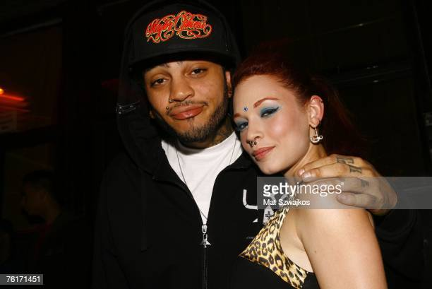 Singer Travis McCoy and Penthouse Pet Justine Joli arrive at McCoy's birthday party at Angels and Kings on August 18 2007 in New York City