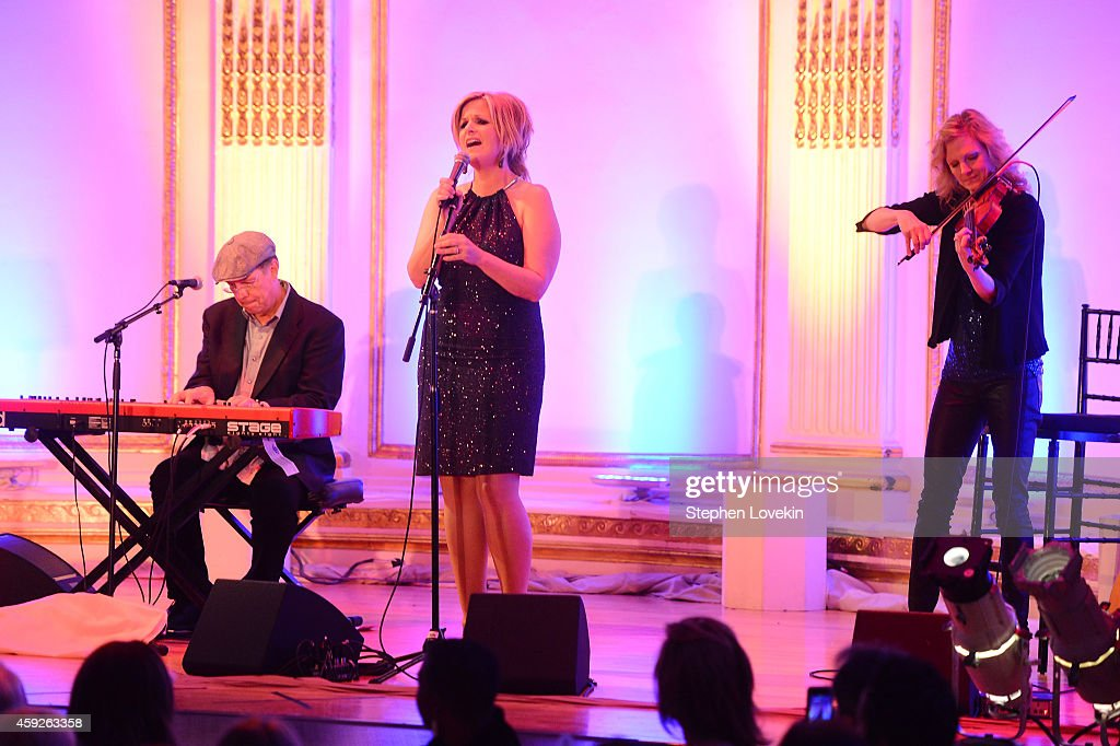 Singer Trisha Yearwood performs on stage at the 2nd Annual Save The Children Illumination Gala at the Plaza on November 19, 2014 in New York City.