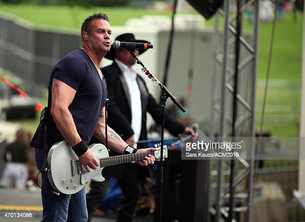 Singer Troy Gentry of Montgomery Gentry perform onstage during the ACM Party For A Cause Festival at Globe Life Park in Arlington on April 17 2015 in...