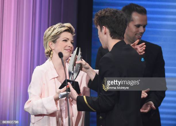 Singer Troye Sivan accepts the Stephen F Kolzak Award from singer Carly Rae Jepsen and songwriter Justin Tranter onstage during the 28th Annual GLAAD...