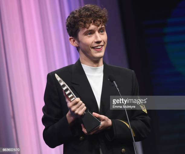 Singer Troye Sivan accepts the Stephen F Kolzak Award onstage during the 28th Annual GLAAD Media Awards in LA at The Beverly Hilton Hotel on April 1...