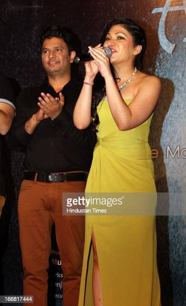 Singer Tulsi Kumar sings as her brother and TSeries Chairman Bhushan Kumar looks at Press conference of upcoming film Aashiqui 2 at Laxmi Studious...