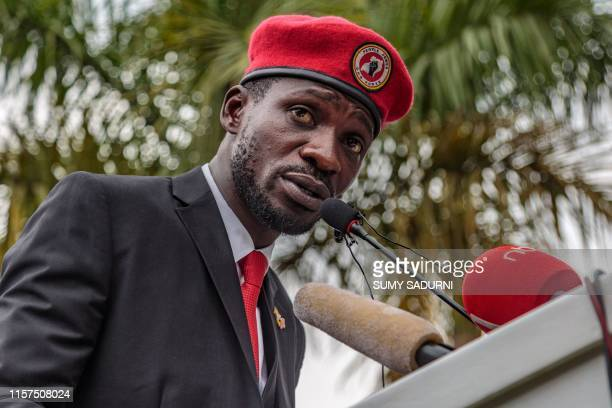 TOPSHOT Singer turned politician Robert Kyagulanyi also known as Bobi Wine speaks during a press conference held at his home in Magere in the...