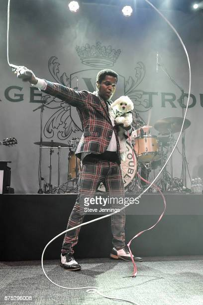 Singer Ty Taylor of Vintage Trouble brings an audience members dog on stage at The Fillmore on November 16 2017 in San Francisco California