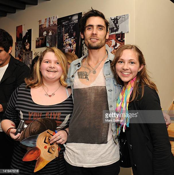 Singer Tyson Ritter of The AllAmerican Rejects poses with fans at The AllAmerican Rejects film a VEVO GO Show presented by Starburst at iam8bit on...