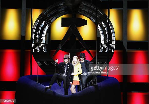 Singer Udo Lindenberg actress Josephin Busch and actor Serkan Kaya attend a photocall for the 'Hinterm Horizont' musical by Udo Lindenberg on January...