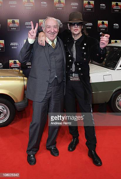 Singer Udo Lindenberg and Dieter Hallervorden arrive for the 'Hinterm Horizont' musical premiere at Theater am Potsdamer Platz on January 13 2011 in...