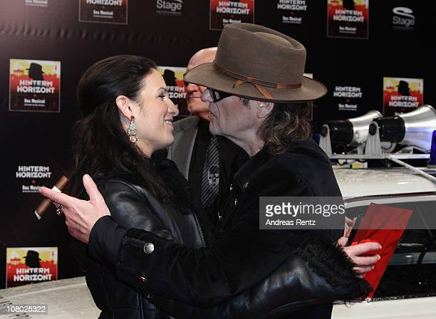 Singer Udo Lindenberg and Minu Barati arrive for the 'Hinterm Horizont' musical premiere at Theater am Potsdamer Platz on January 13 2011 in Berlin...