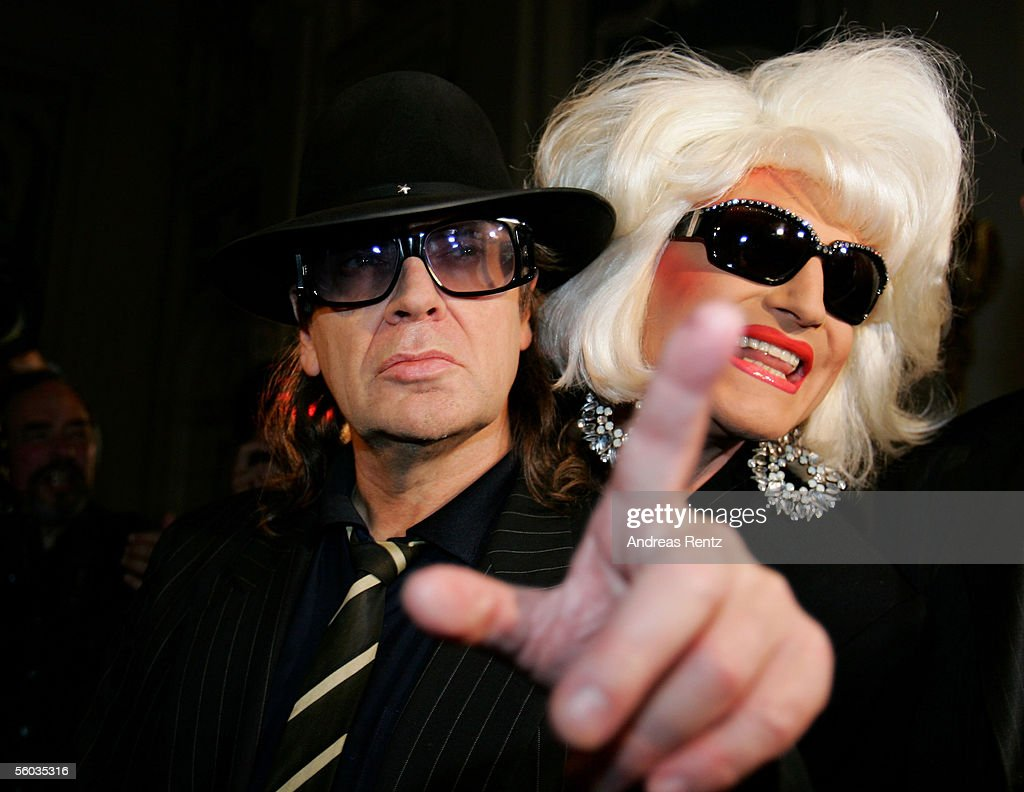 Singer Udo Lindenberg (L) and Olivia Jones attend at the aftershow party of the fashion charity Gala 'Event Prominent' at the Atlantic Hotel on October 30, 2005 in Hamburg, Germany. The proceeds of the event goes traditionally to the hospice Hamburg 'Leuchtfeuer' and 'Dunkelziffer e.V.'