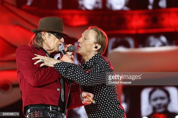 Singer Udo Lindenberg and singer Marius Mueller Westernhagen perform live during the opening night of the 'Keine Panik' tour at VeltinsArena on May...