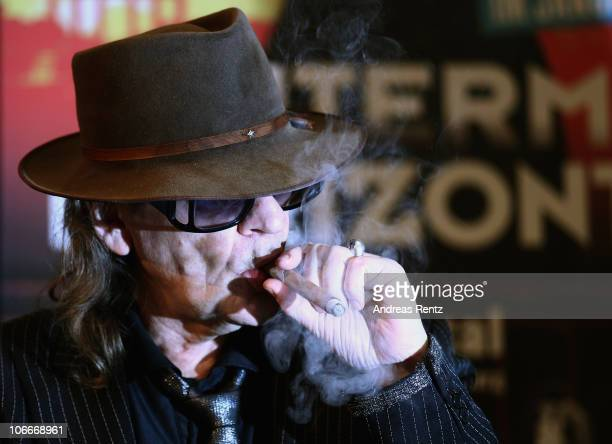 Singer Udo Lindenberg smokes a cigar during the rehearsal for the 'Hinterm Horizont' musical by Udo Lindenberg at Ballhaus Rixdorf Studios on...