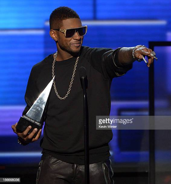 Singer Usher accepts the award for Favorite Soul/RB Male Artist onstage during the 40th American Music Awards held at Nokia Theatre LA Live on...