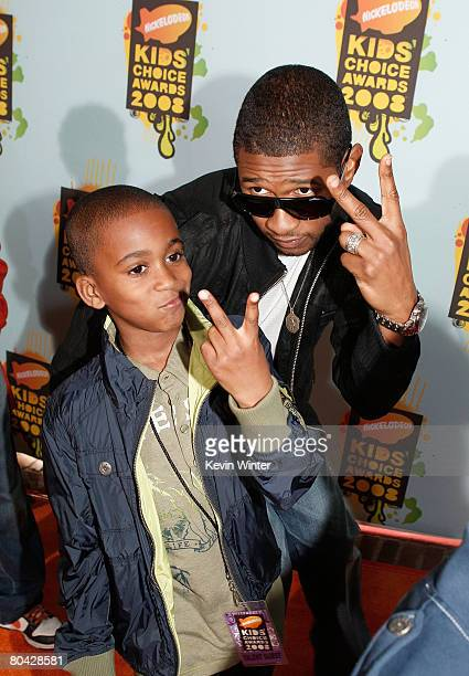 Singer Usher and guest arrive at Nickelodeon's 2008 Kids' Choice Awards held at UCLA's Pauley Pavilion on March 29 2008 in Westwood California