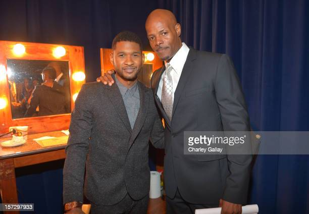 Singer Usher and producer/director Keenen Ivory Wayans attend UNCF's 34th Annual An Evening Of Stars held at Pasadena Civic Auditorium on December 1...