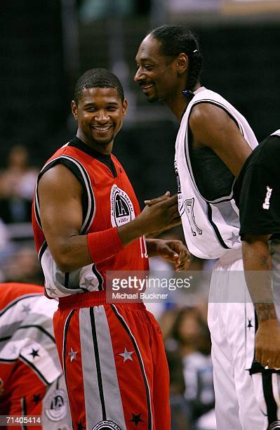 Singer Usher and rapper Snoop Dogg play at the Midsummer Night's Dream Celebrity Basketball Game at the Staples Center on July 9 2006 in Los Angeles...