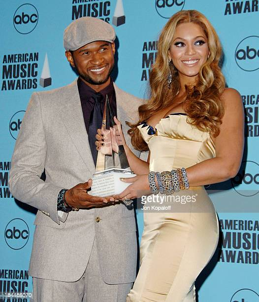 Singer Usher and singer Beyonce in the press room at the 2007 American Music Awards at the Nokia Theatre on November 18 2007 in Los Angeles California