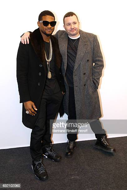 Singer Usher and Stylist Kim Jones pose Backstage after the Louis Vuitton Menswear Fall/Winter 20172018 show as part of Paris Fashion Week Held at...