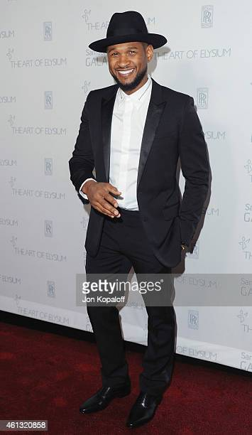 Singer Usher arrives at The Art Of Elysium 8th Annual Heaven Gala at Hangar 8 on January 10 2015 in Santa Monica California