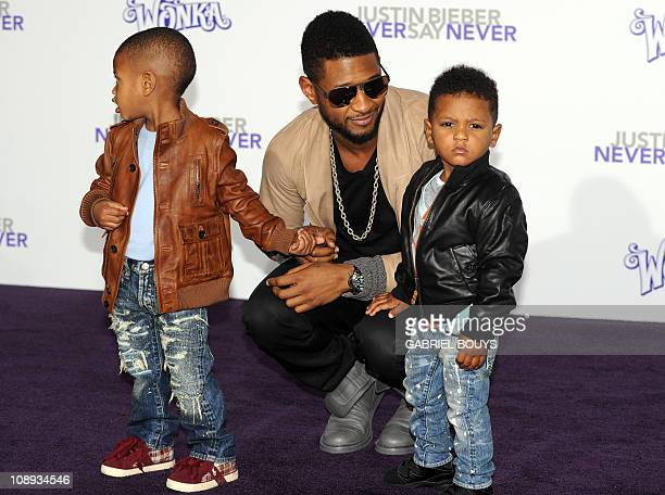 "Singer Usher arrives with his children at the premiere of Justin Bieber Never say Never"" in Los Angeles California on February 8 2011 AFP PHOTO /..."