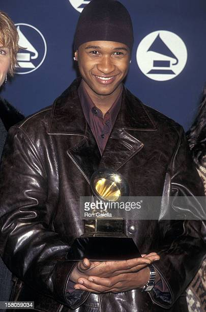 Singer Usher attends the 40th Annual Grammy Awards Nominations Announcement on January 6 1998 at Radio City Music Hall in New York City