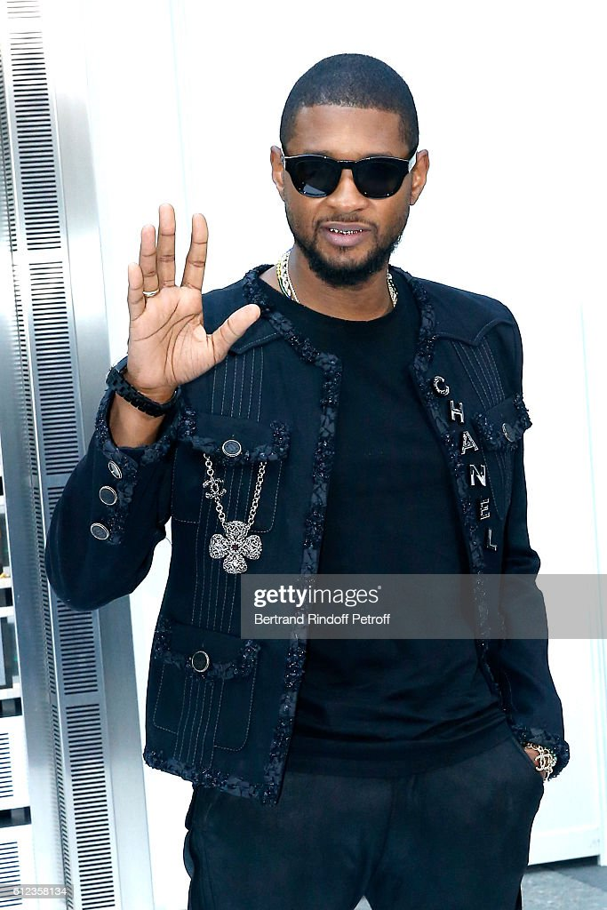Singer Usher attends the Chanel show as part of the Paris Fashion Week Womenswear Spring/Summer 2017 on October 4, 2016 in Paris, France.