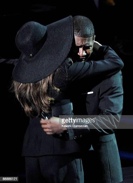 Singer Usher hugs LaToya Jackson at the Michael Jackson public memorial service held at Staples Center on July 7, 2009 in Los Angeles, California....