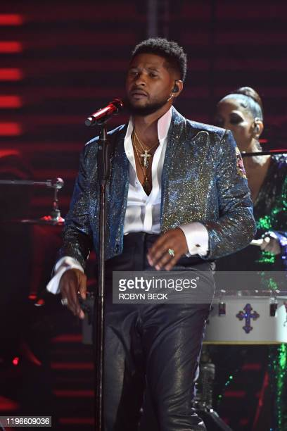 Singer Usher performs a tribute to late US singer-songwriter Prince during the 62nd Annual Grammy Awards on January 26 in Los Angeles.