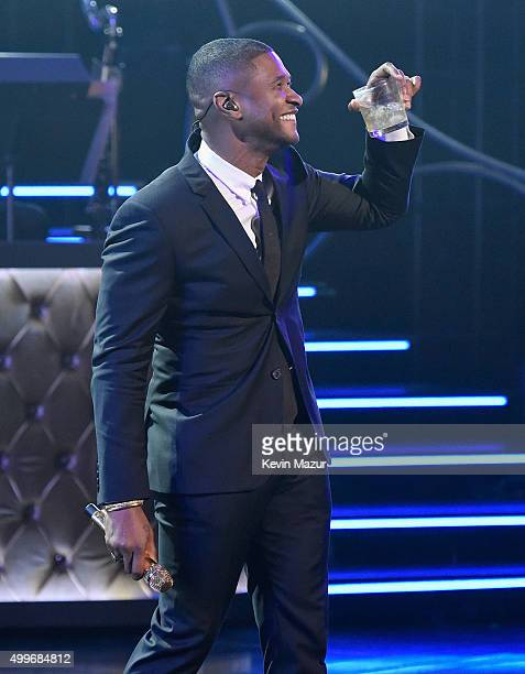 Singer Usher performs during 'Sinatra 100 An AllStar GRAMMY Concert' celebrating the late Frank Sinatra's 100th birthday at the Encore Theater at...