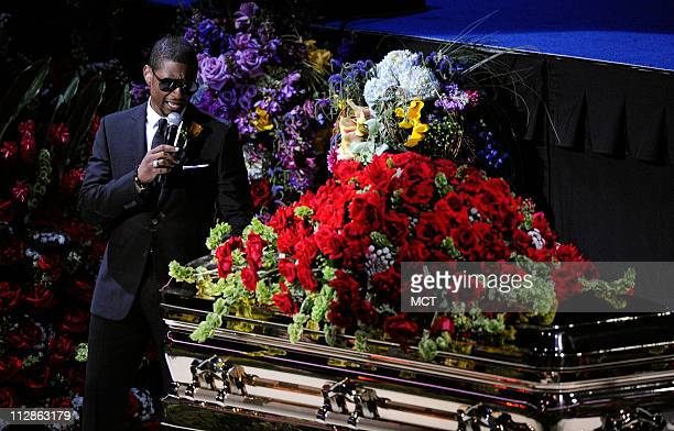 Singer Usher performs next to the casket at the Michael Jackson public memorial service held at Staples Center on July 7 2009 in Los Angeles...
