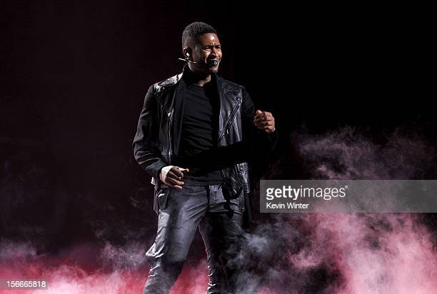 Singer Usher performs onstage during the 40th American Music Awards held at Nokia Theatre LA Live on November 18 2012 in Los Angeles California