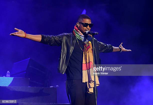 Singer Usher performs onstage with Major Lazer during day 3 of the 2016 Coachella Valley Music Arts Festival Weekend 2 at the Empire Polo Club on...