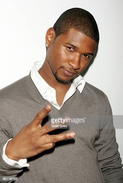 Singer Usher poses backstage during MTV's Total Request Live at the MTV Times Square Studios November 7 2005 in New York City