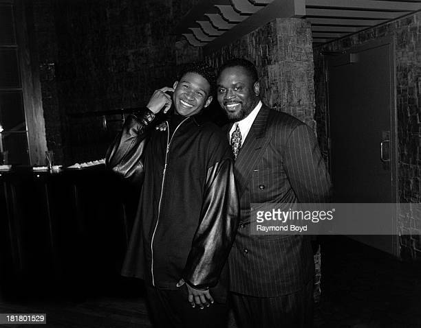 Singer Usher poses for photos with record executive L.A. Reid, at the Ritz-Carlton Hotel in Chicago, Illinois in JANUARY 1995.