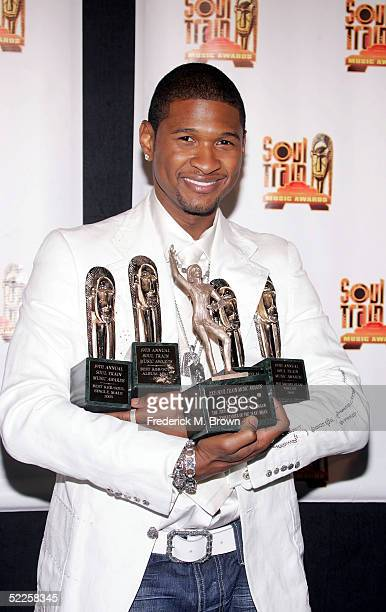 B singer Usher poses with his awards in the photo room at the 19th Annual Soul Train Music Awards at Paramount Studios on February 28 2005 in Los...