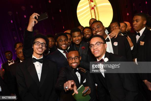 Singer Usher Raymond with Morehouse students at Morehouse College 150th Anniversary 29th Annual A Candle In The Dark Gala at The Hyatt Regency...