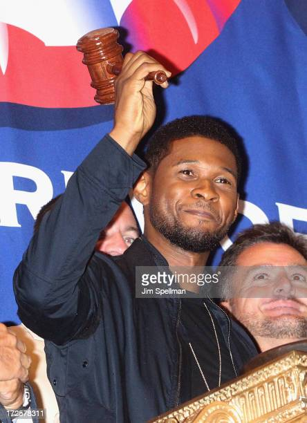 Singer Usher rings the closing bell at the New York Stock Exchange on July 3 2013 in New York City