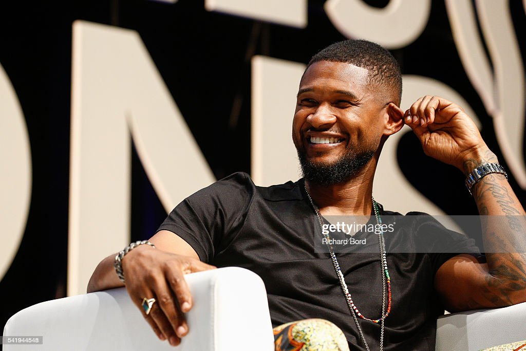 Singer Usher speaks to Ryan Seacrest during 'An Intimate Conversation with Usher' Seminar hosted by iHeartMedia during The Cannes Lions Festival 2016 on June 21, 2016 in Cannes, France.