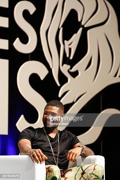 Singer Usher speaks to Ryan Seacrest during 'An Intimate Conversation with Usher' Seminar hosted by iHeartMedia during The Cannes Lions Festival 2016...