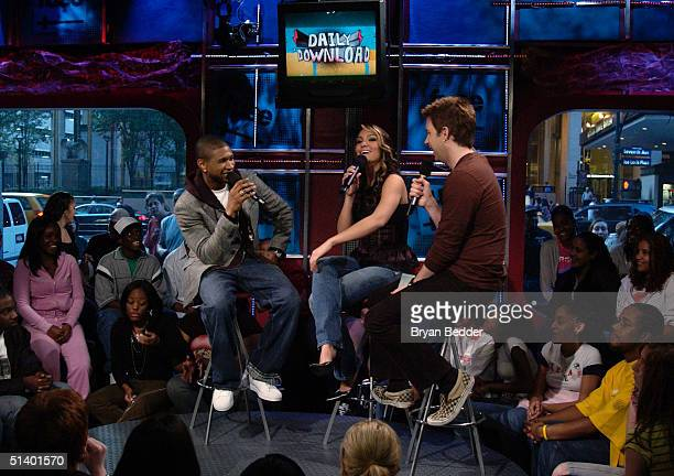 Singer Usher talks with VJ's Marianela Pereyra and Steve Smith during FUSE TV's Daily Download show October 4, 2004 in New York City.