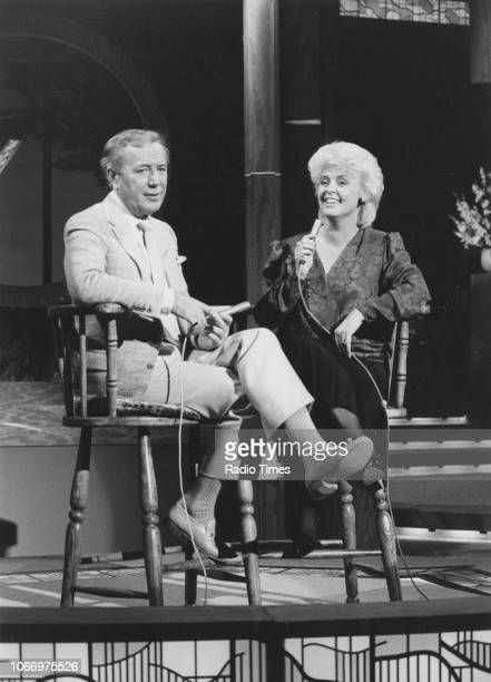 Singer Val Doonican and television personality Gloria Hunniford in conversation on the television series 'The Val Doonican Music Show' May 23rd 1985