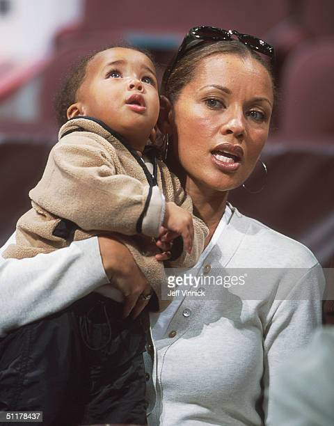 Singer Vanessa Williams holds her son Sasha as she watches an NBA game February 4 2001 in Vancouver Canada Williams is married to LA Lakers player...
