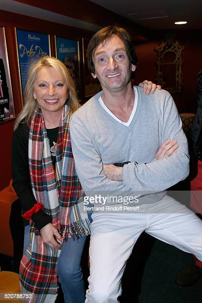 Singer Veronique Sanson and humorist Pierre Palmade pose after the Robert Charlebois '50 ans 50 chansons' Concert at Bobino on April 12 2016 in Paris...