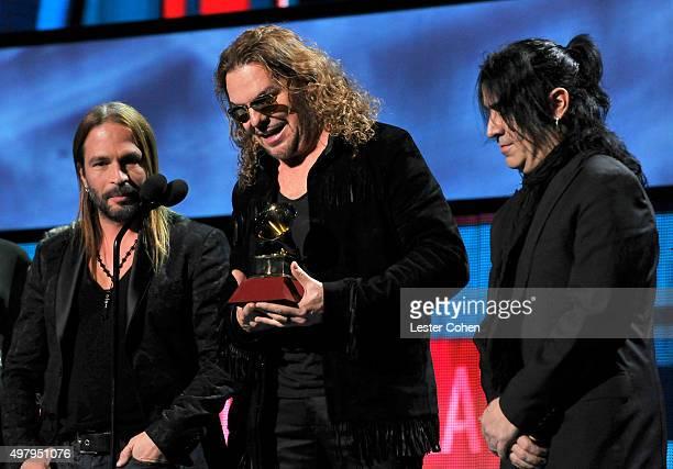 Singer Victor Manuelle presents musicians Sergio Vallin Juan Calleros Fher Olvera and Alex Gonzalez of Mana with the Best Pop/Rock Album Award for...