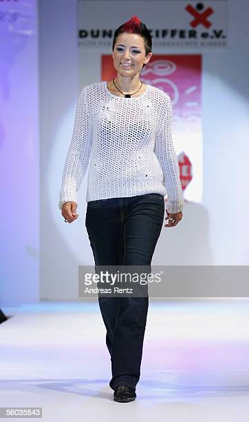 Singer Villaine poses on the catwalk during the fashion charity Gala 'Event Prominent' at the Atlantic Hotel on October 30 2005 in Hamburg Germany...