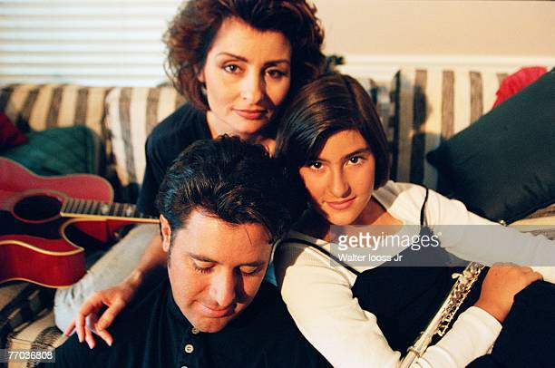 Singer Vince Gill poses for a photo with his wife Janis Gill and daughter Jenny Gill during a circa 1990s photo shoot at their home in Nashville...