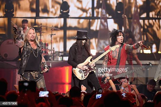 Singer Vince Neil guitarist Mick Mars and bassist Nikki Sixx of Motley Crue perform onstage during the 2014 iHeartRadio Music Festival at the MGM...